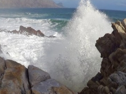 Large ocean waves crashing into rocky shore - natural ocean wave sounds